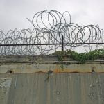 "razor wire surrounds prisons where thousands of addicts are incarcerated for their ""choice"""